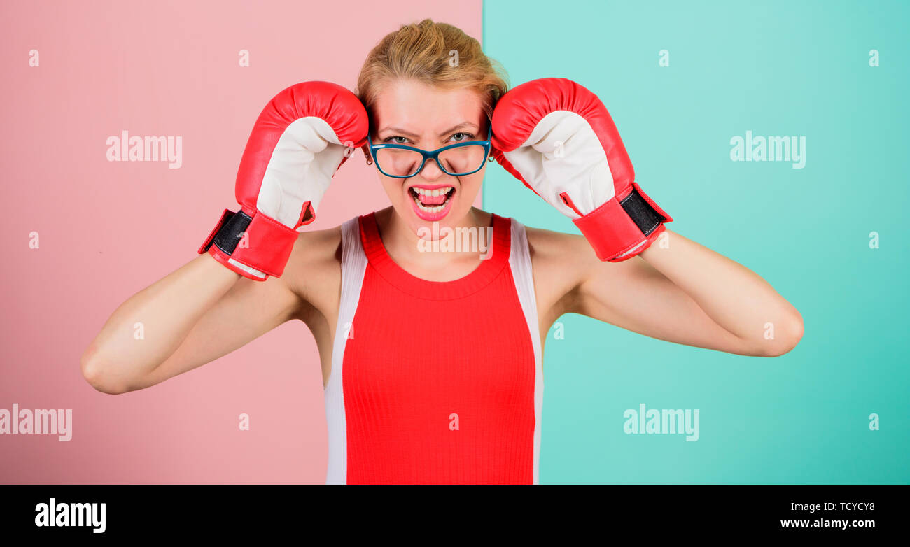 Win with strength or intellect. Strong intellect victory pledge. Know how defend myself. Confident her power. Strong mentally and physically. Smart and strong. Woman boxing gloves adjust eyeglasses. - Stock Image
