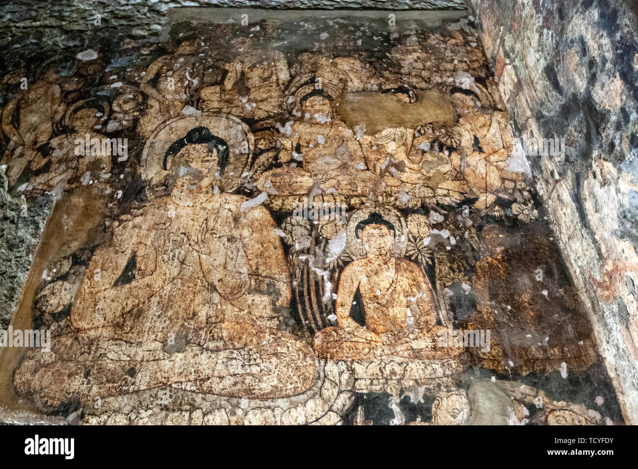 painting in Cave 6: Buddha seated in dharma-chakra-mudra, Cave 6, Ajanta Caves, Aurangabad District, Maharashtra State, India - Stock Image