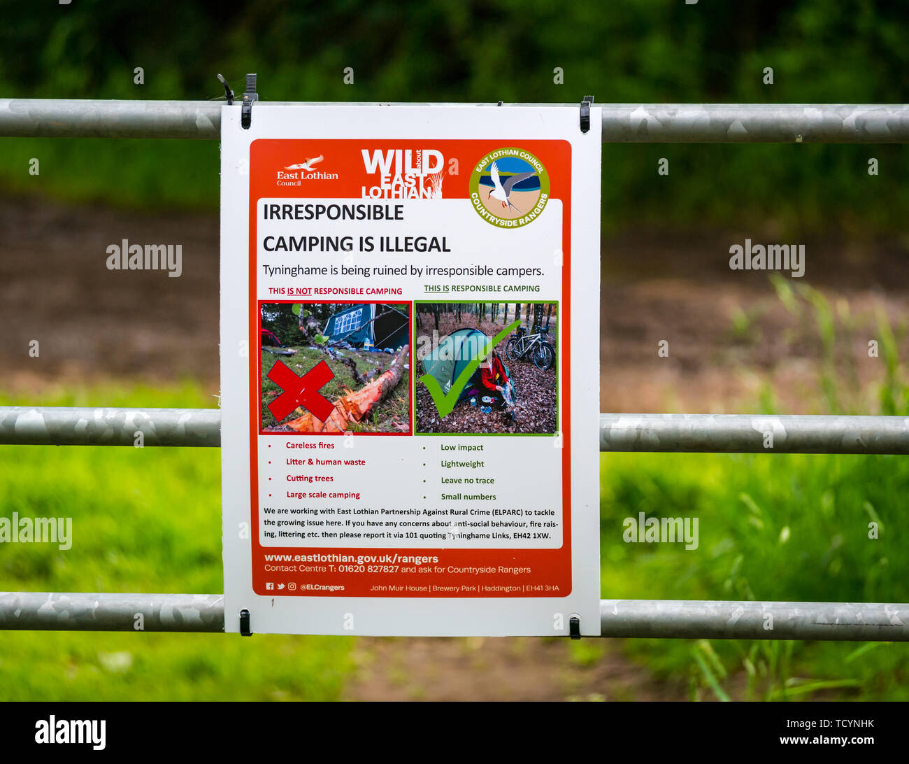 East Lothian Council notice warning about irresponsible wild camping on a rural gate, Tynnghame, Scotland, UK - Stock Image