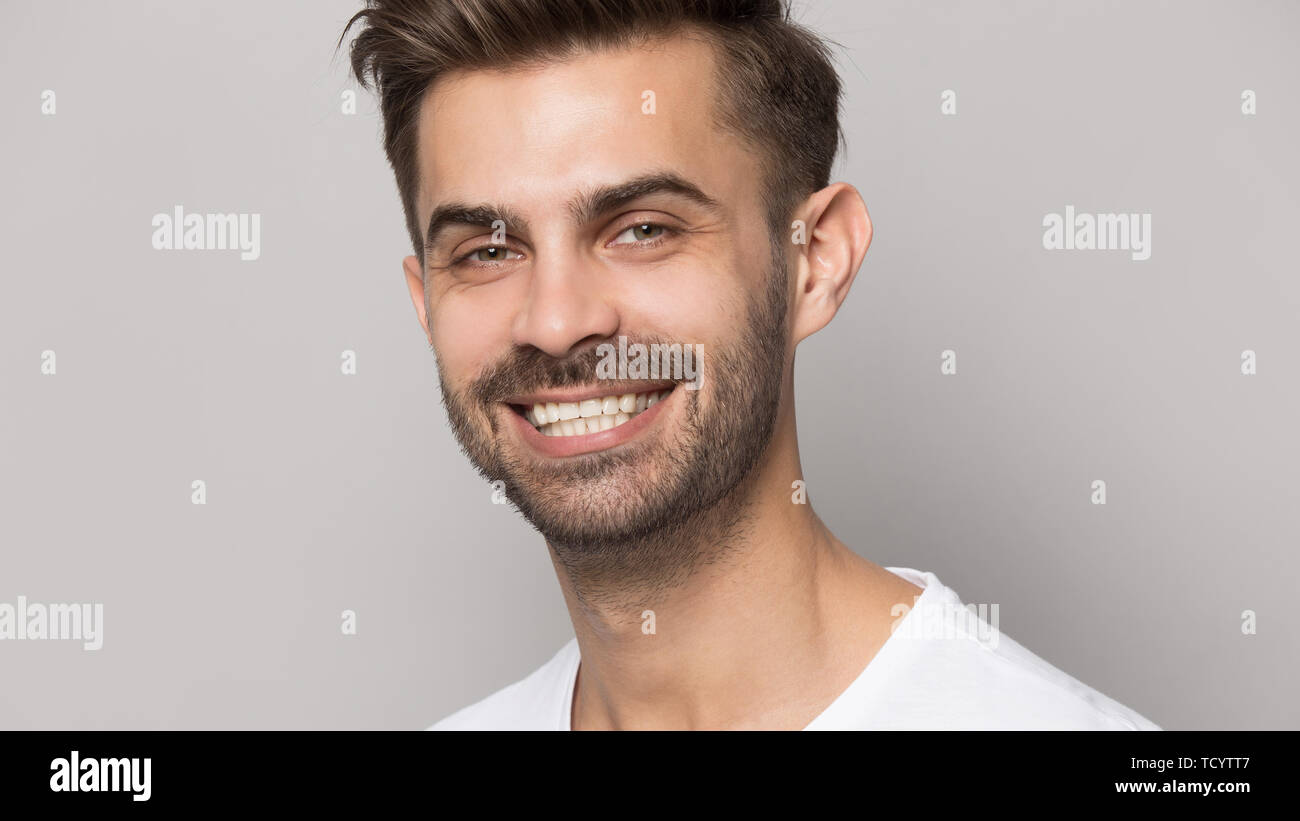 Closeup portrait young man with white toothy smile - Stock Image