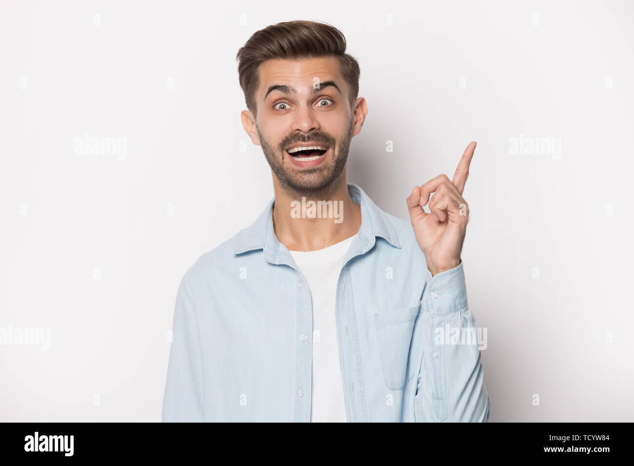 Guy raised finger up gesture of resourceful person studio shot - Stock Image