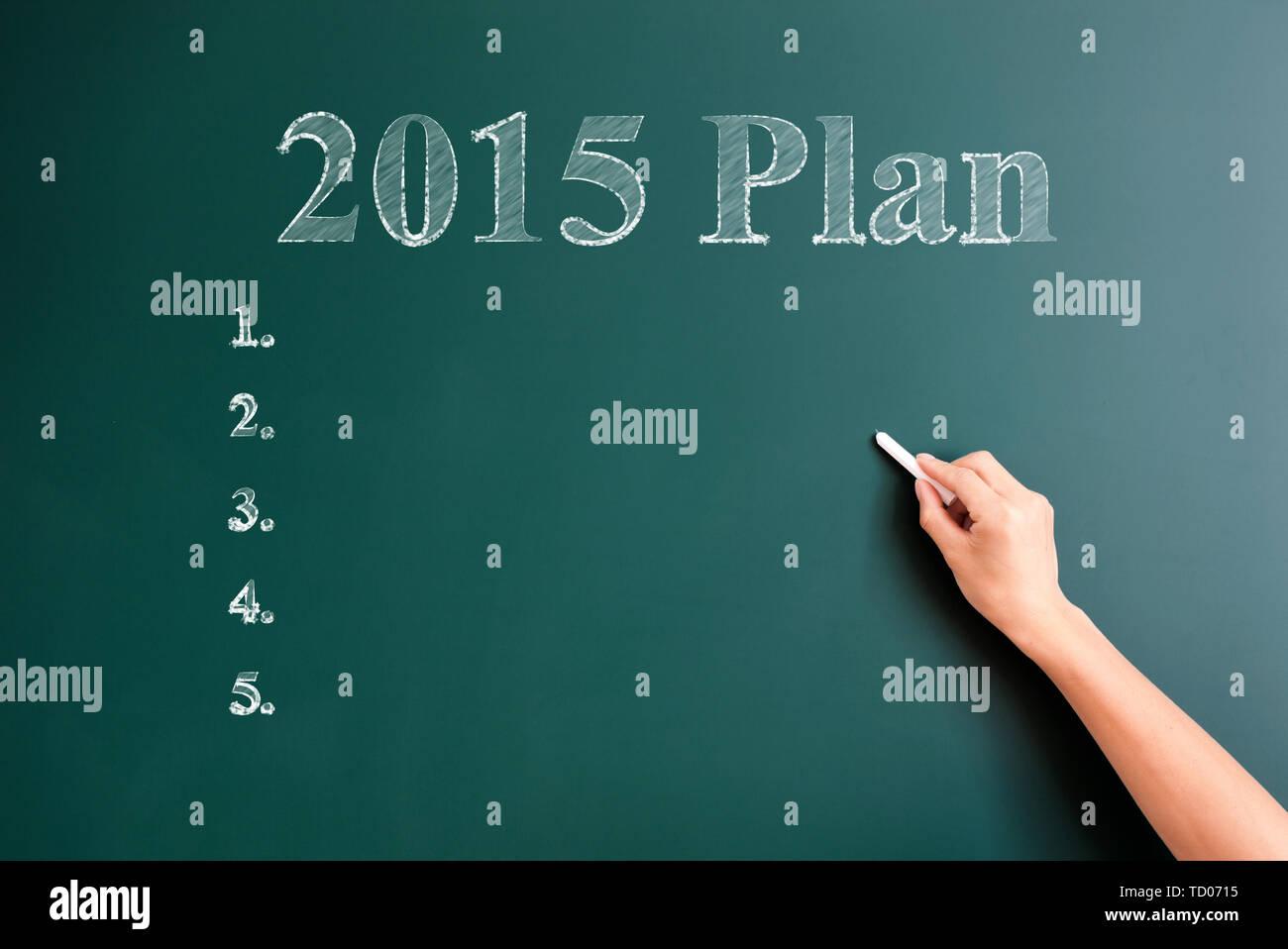 2015 plan written on blackboard - Stock Image