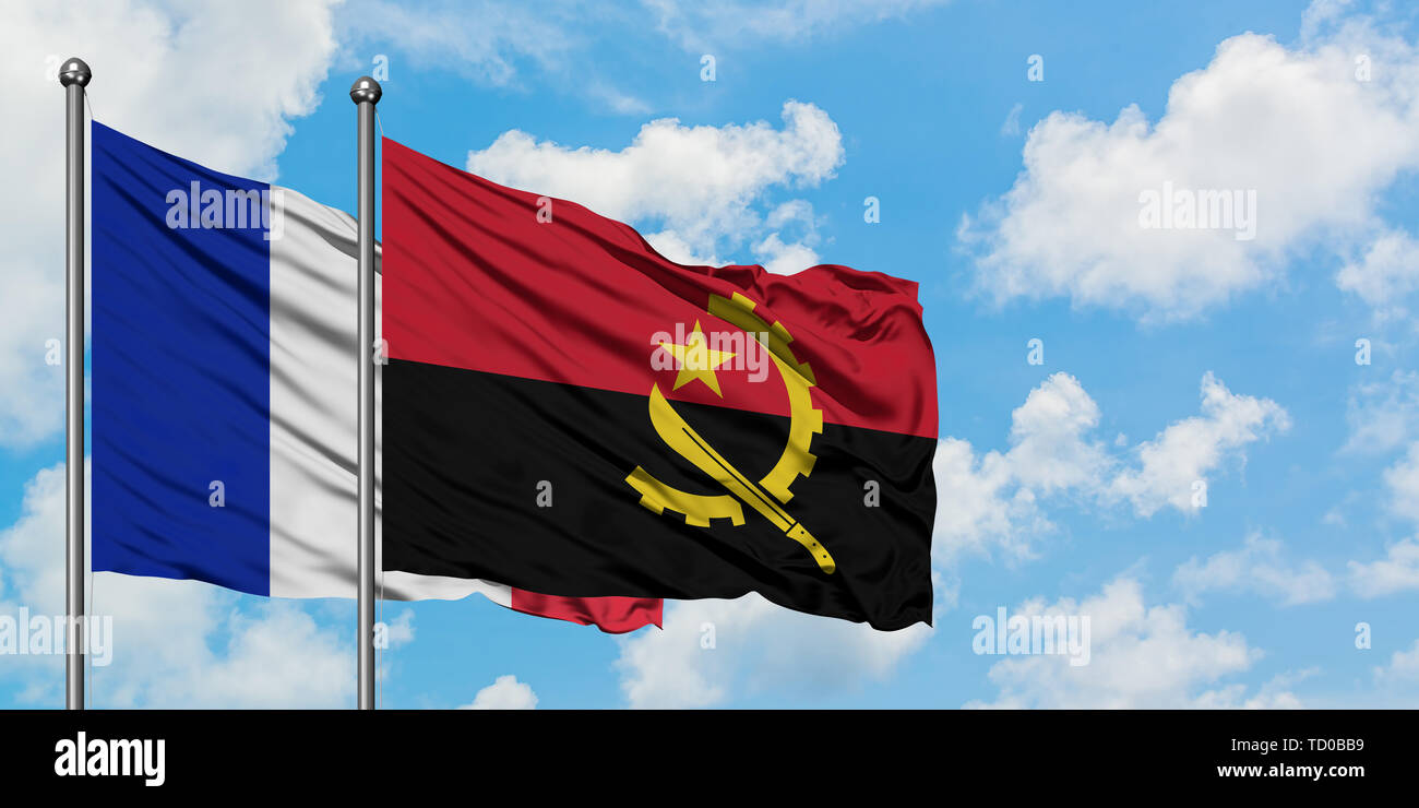 France and Angola flag waving in the wind against white cloudy blue sky together. Diplomacy concept, international relations. - Stock Image