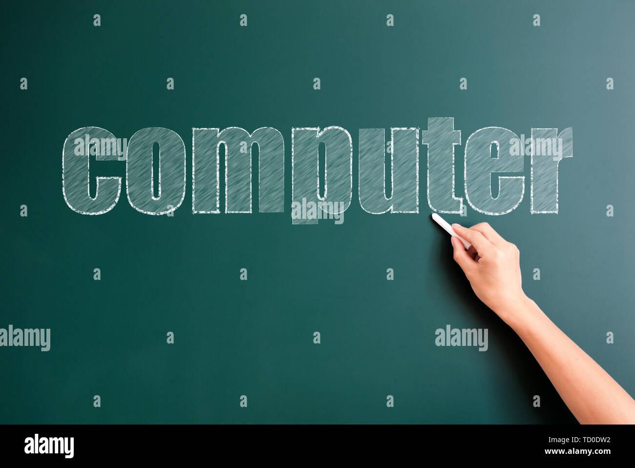 computer written on blackboard - Stock Image