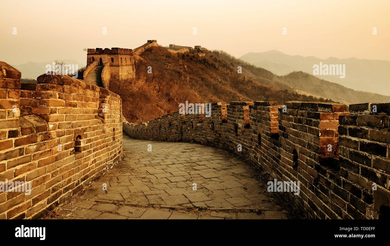 Great Wall sunset over mountains in Beijing, China. - Stock Image