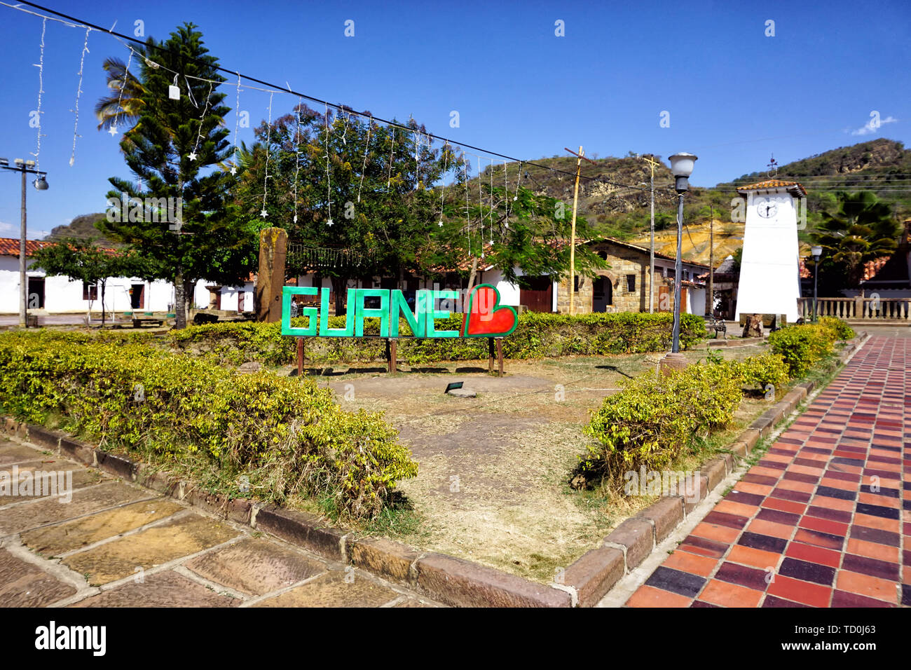 Panorama of the main square and tower clock in Guane, Colombia - Stock Image