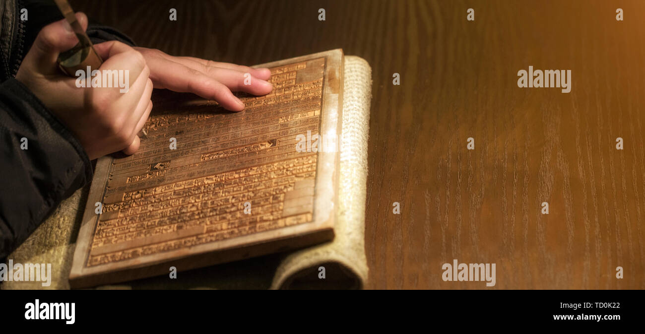 Craftsman engraved chinese characters on wood blocks. Woodblock printing is one of the greatest invention of chinese people. - Stock Image