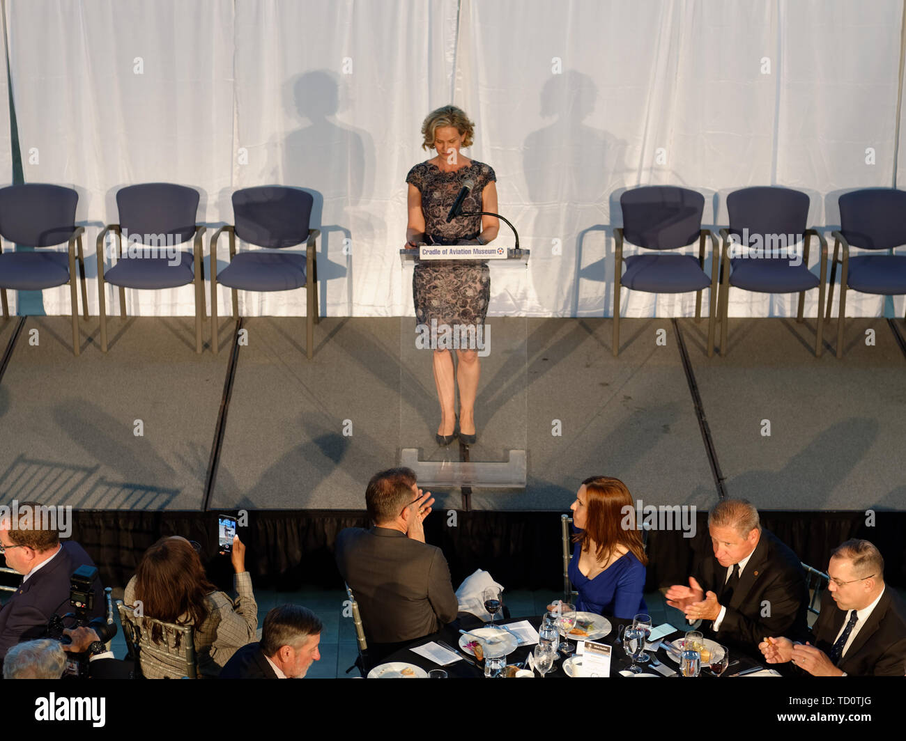Garden City, New York, USA. 6th June, 2019. Nassau County Executive LAURA GILLEN is speaking on stage below, as seen from second level of atrium of Cradle of Aviation Museum, during Apollo at 50 Anniversary Dinner, an Apollo astronaut tribute celebrating the Apollo 11 mission Moon landing. Credit: Ann Parry/ZUMA Wire/Alamy Live News - Stock Image