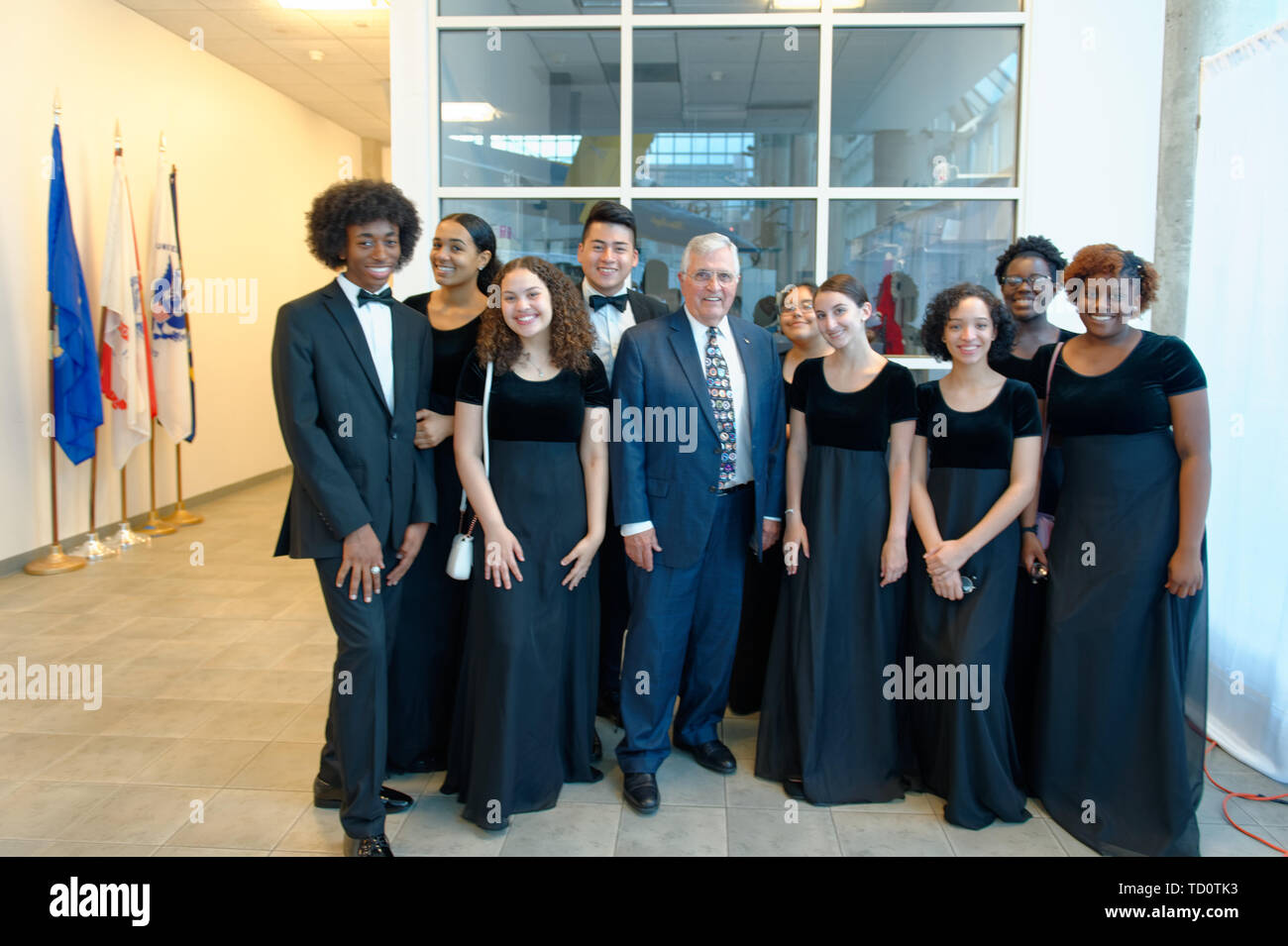 Garden City, New York, USA. 6th June, 2019. Apollo 17 astronaut HARRISON SCHMITT, at center, poses with Freeport High School Select Chorale members soon to perform at Apollo at 50 Anniversary Dinner at Cradle of Aviation Museum. Credit: Ann Parry/ZUMA Wire/Alamy Live News - Stock Image