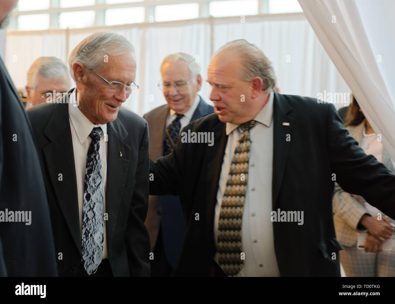 Garden City, New York, USA. 6th June, 2019. At left, Apollo 16 astronaut CHARLIE DUKE is about to walk through entrance curtain, at Cradle of Aviation Museum, to Apollo at 50 Anniversary Dinner, an Apollo astronaut tribute celebrating the Apollo 11 mission Moon landing. Credit: Ann Parry/ZUMA Wire/Alamy Live News - Stock Image