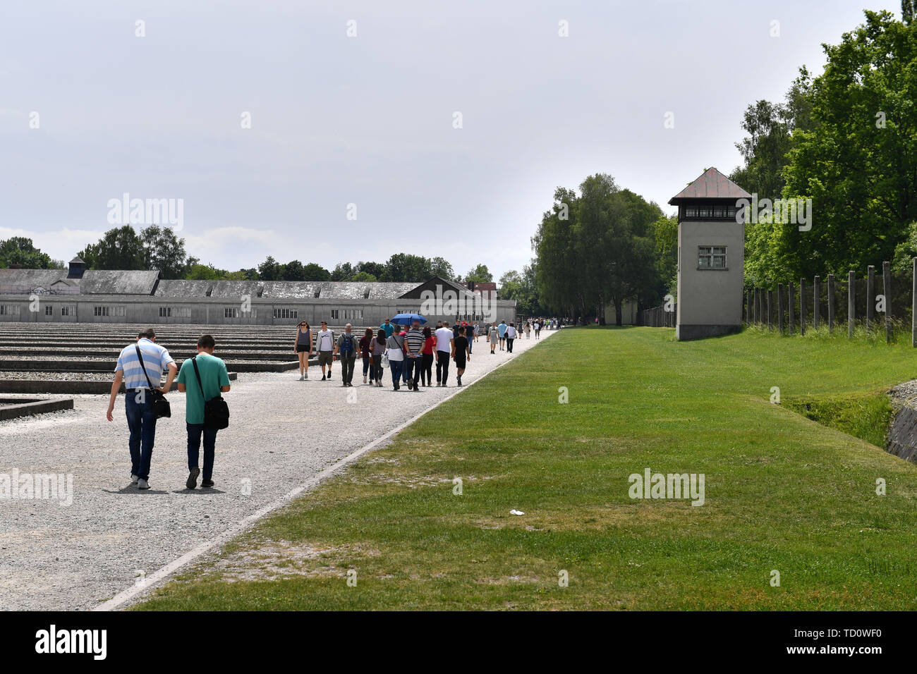 Dachau, Deutschland. 10th June, 2019. Visitors in the Gedenkstaette Concentration Camp Dachau- Gedenkstaette, 1933, 1945, 3, antisewithism, exterminate, extermination, Bavaria, Dachau, deportation, German, German history, Germany, third, Europe, fascism, fascists, fascist, commemoration, memorial, history, Jew, concentration camp, concentration camp, memorial, Nazism, Nazi, Nazis, Nazi, Reich, crime, past, annihilation, extermination camp | usage worldwide Credit: dpa/Alamy Live News - Stock Image