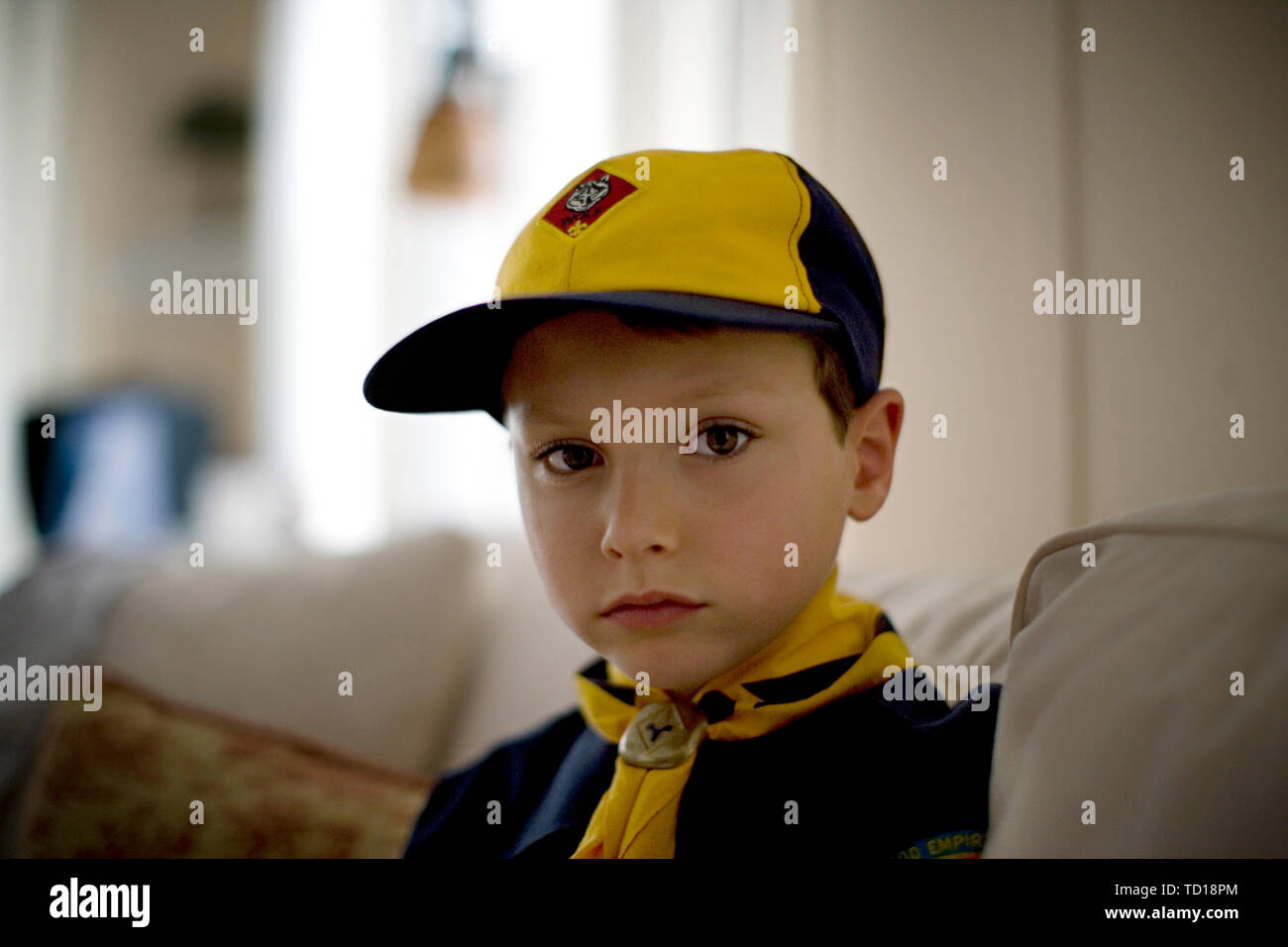 Portrait of a young boy wearing a scouts uniform. - Stock Image