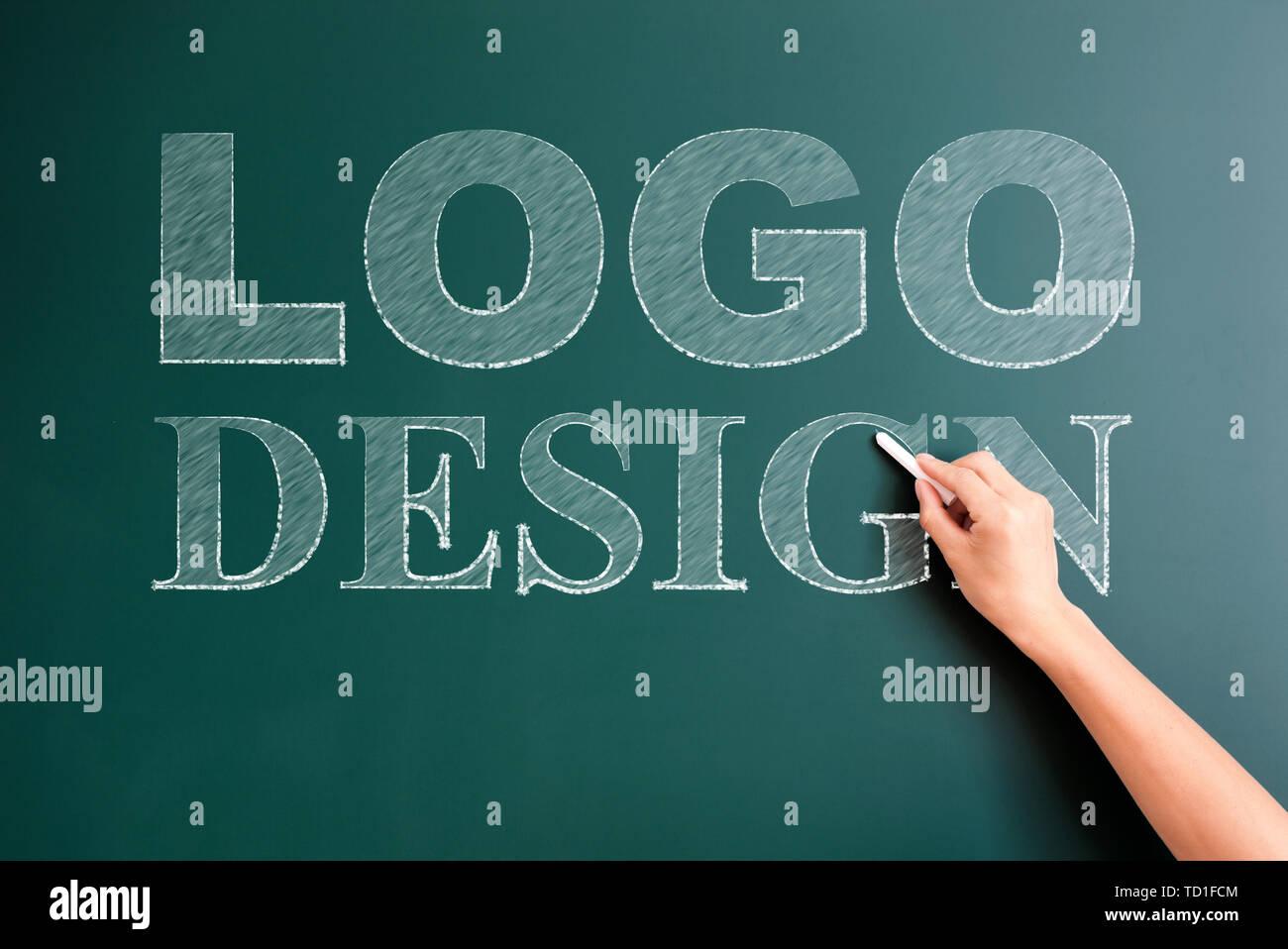 logo written on blackboard - Stock Image