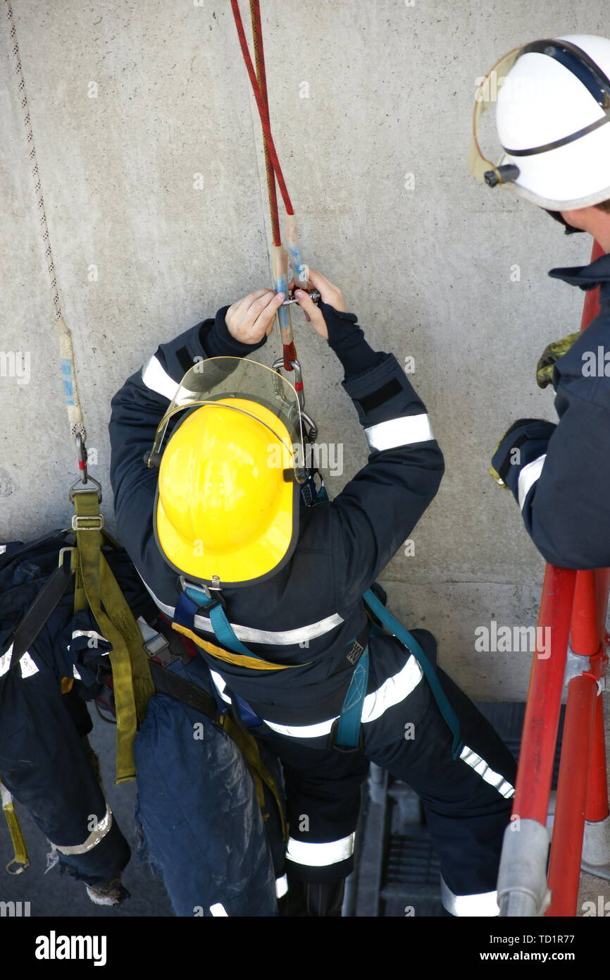 fire fighters working at hight, rescuing victim - Stock Image