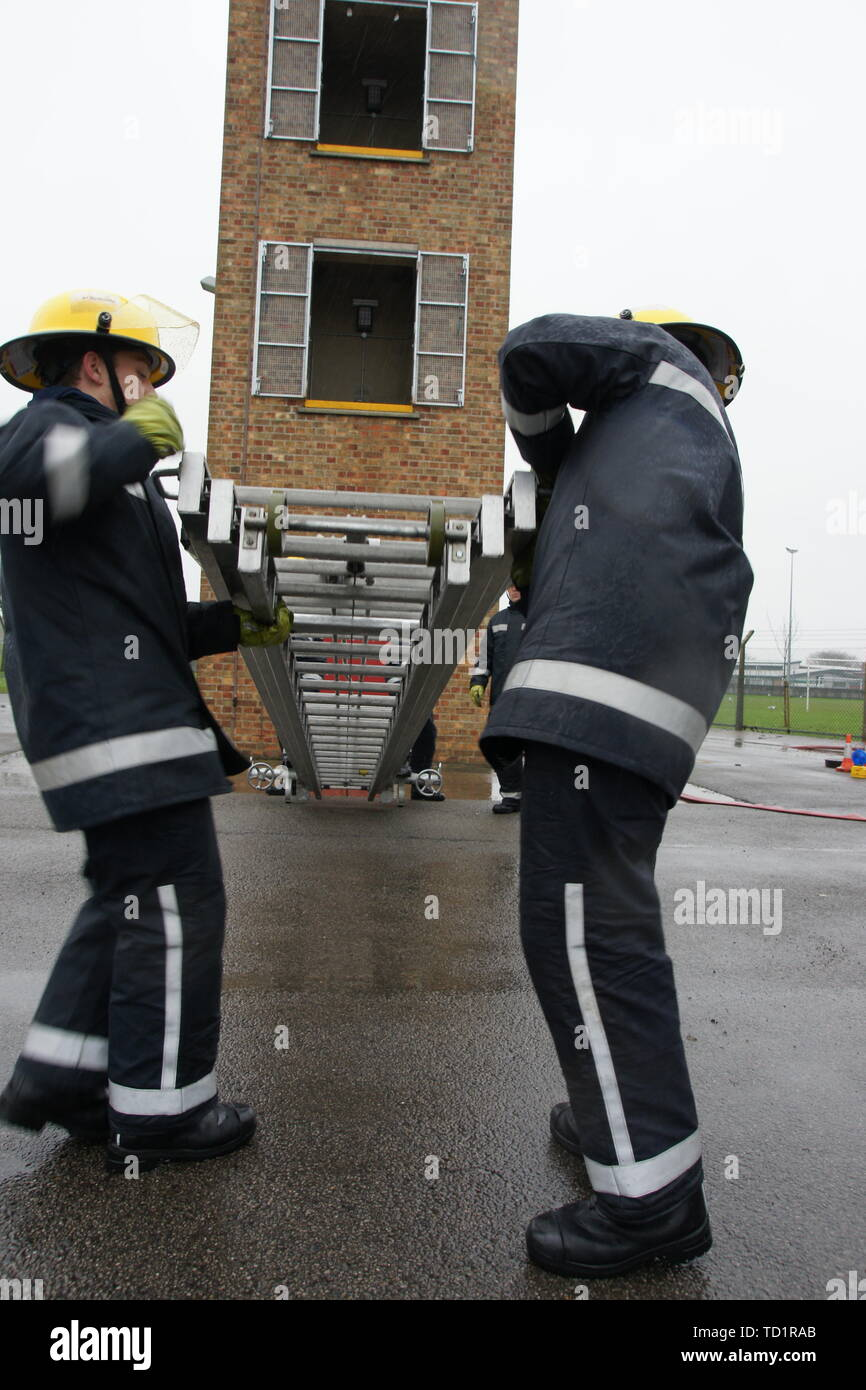 fire fighters working at hight, 13.5m ladder - Stock Image