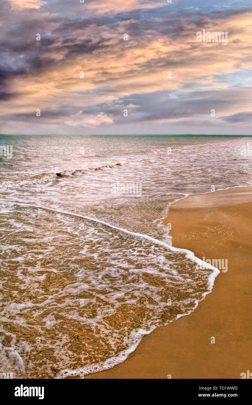 Tranquil beach just before a storm, Hainan Island, China - Stock Image