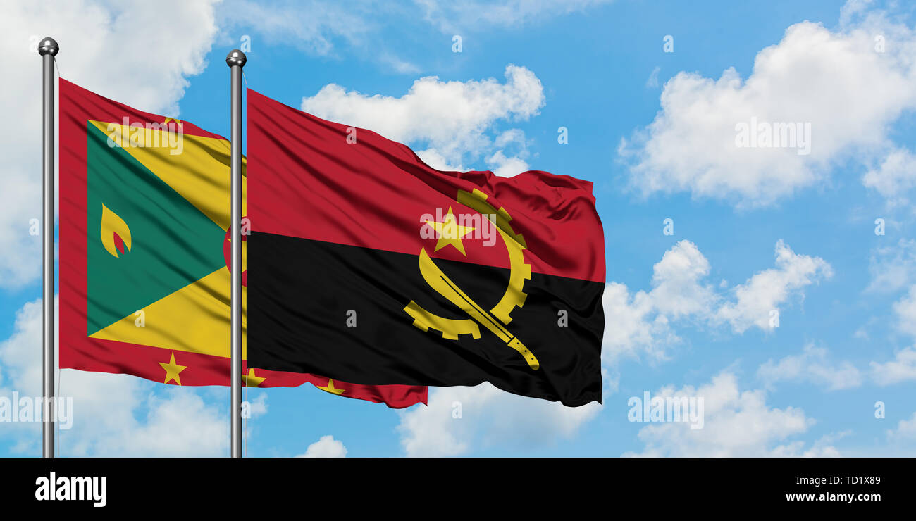 Grenada and Angola flag waving in the wind against white cloudy blue sky together. Diplomacy concept, international relations. - Stock Image