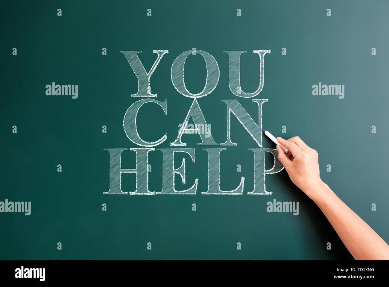 you can help written on blackboard - Stock Image