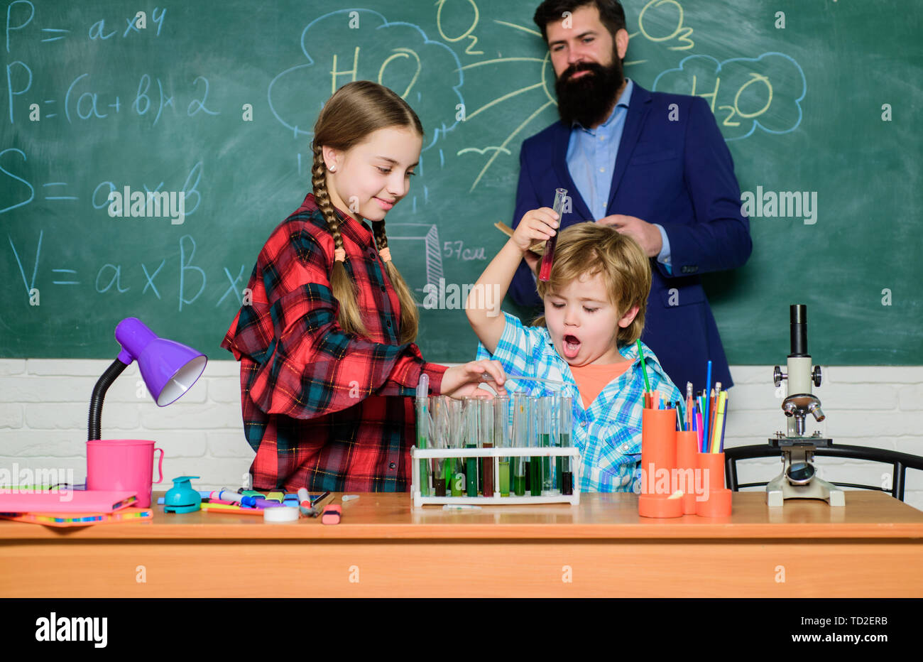 Formal education. Group interaction communication. Practical knowledge. Teaching kids sharing important knowledge. Study with friends is fun. Younger learn from older. With experience comes knowledge. - Stock Image