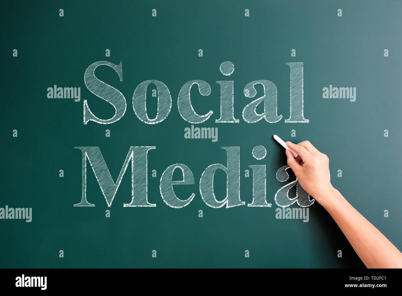 social media written on blackboard - Stock Image