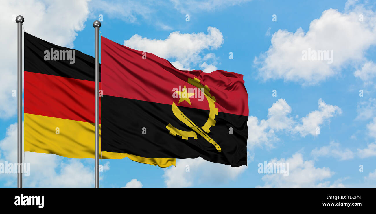 Germany and Angola flag waving in the wind against white cloudy blue sky together. Diplomacy concept, international relations. - Stock Image