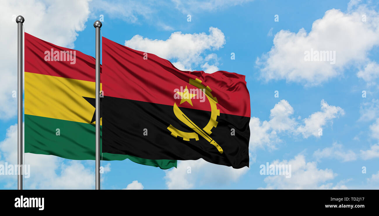 Ghana and Angola flag waving in the wind against white cloudy blue sky together. Diplomacy concept, international relations. - Stock Image