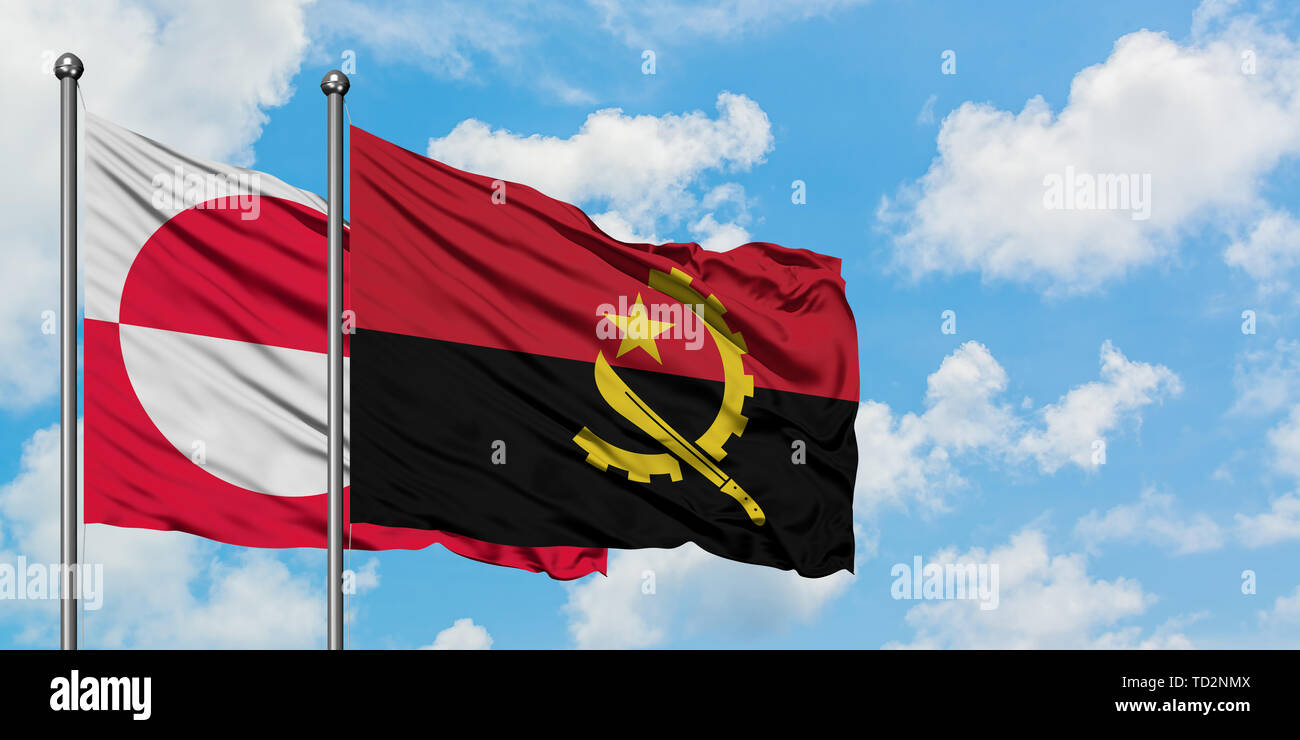 Greenland and Angola flag waving in the wind against white cloudy blue sky together. Diplomacy concept, international relations. - Stock Image