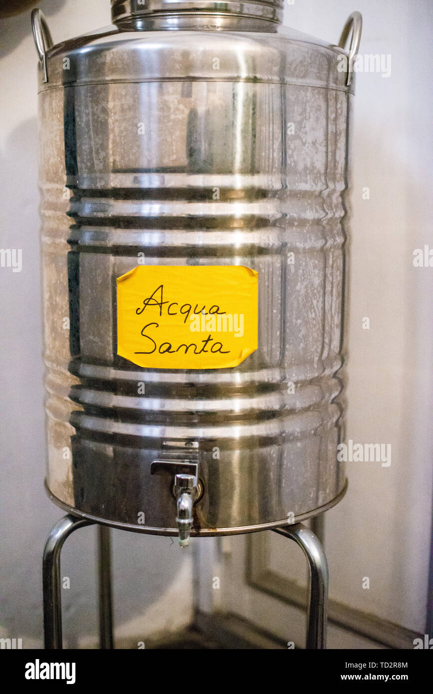 large carboy container full of holy water - Stock Image
