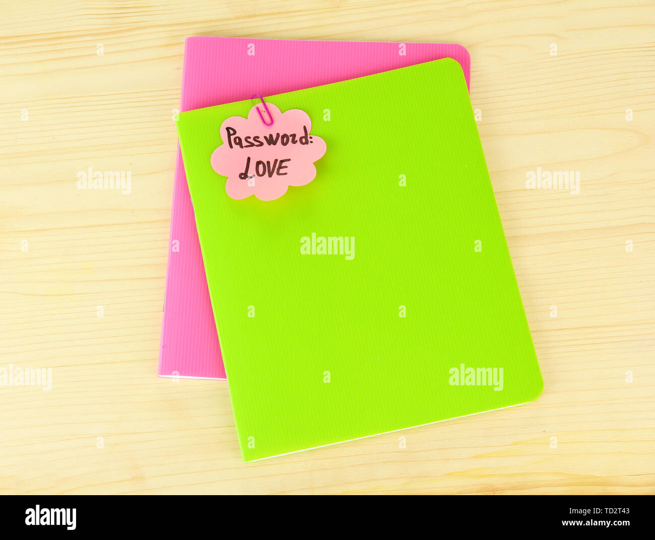 Sticker-reminder with most popular password, on notebook, on wooden background - Stock Image