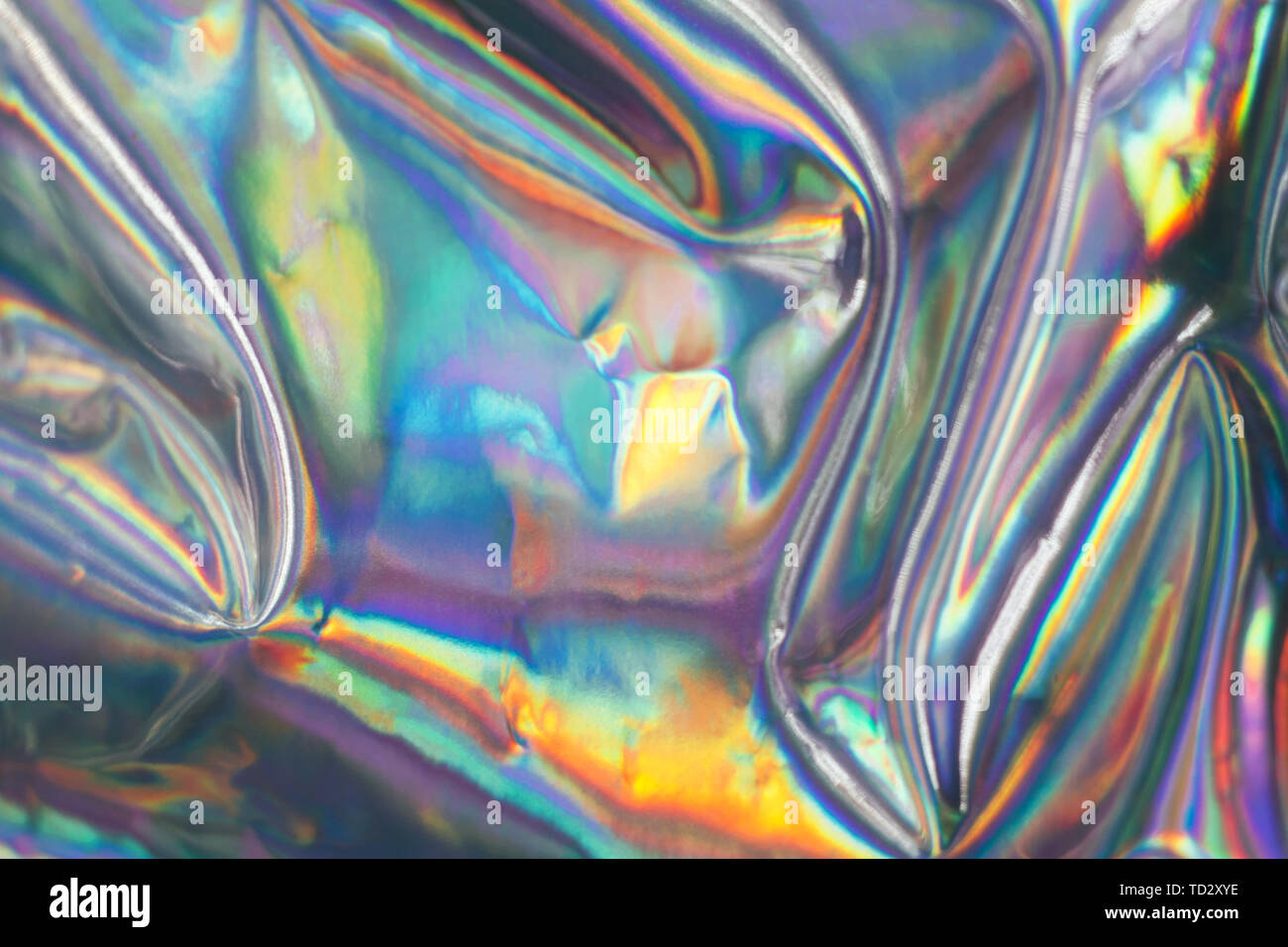 Holographic iridescent abstract blurred surface. Holographic gradient. Stock Photo