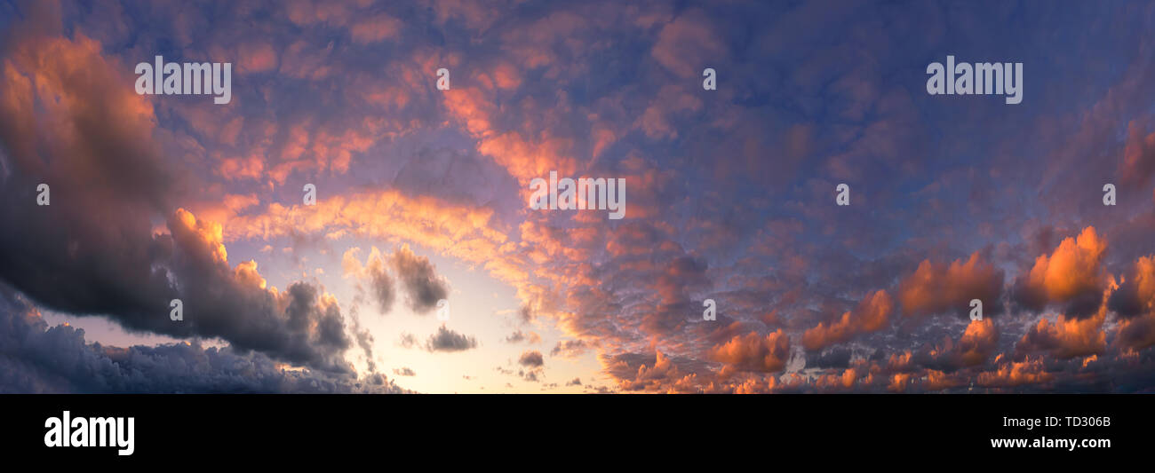 panorama of beautiful cloudscape with red clouds at sunset - Stock Image