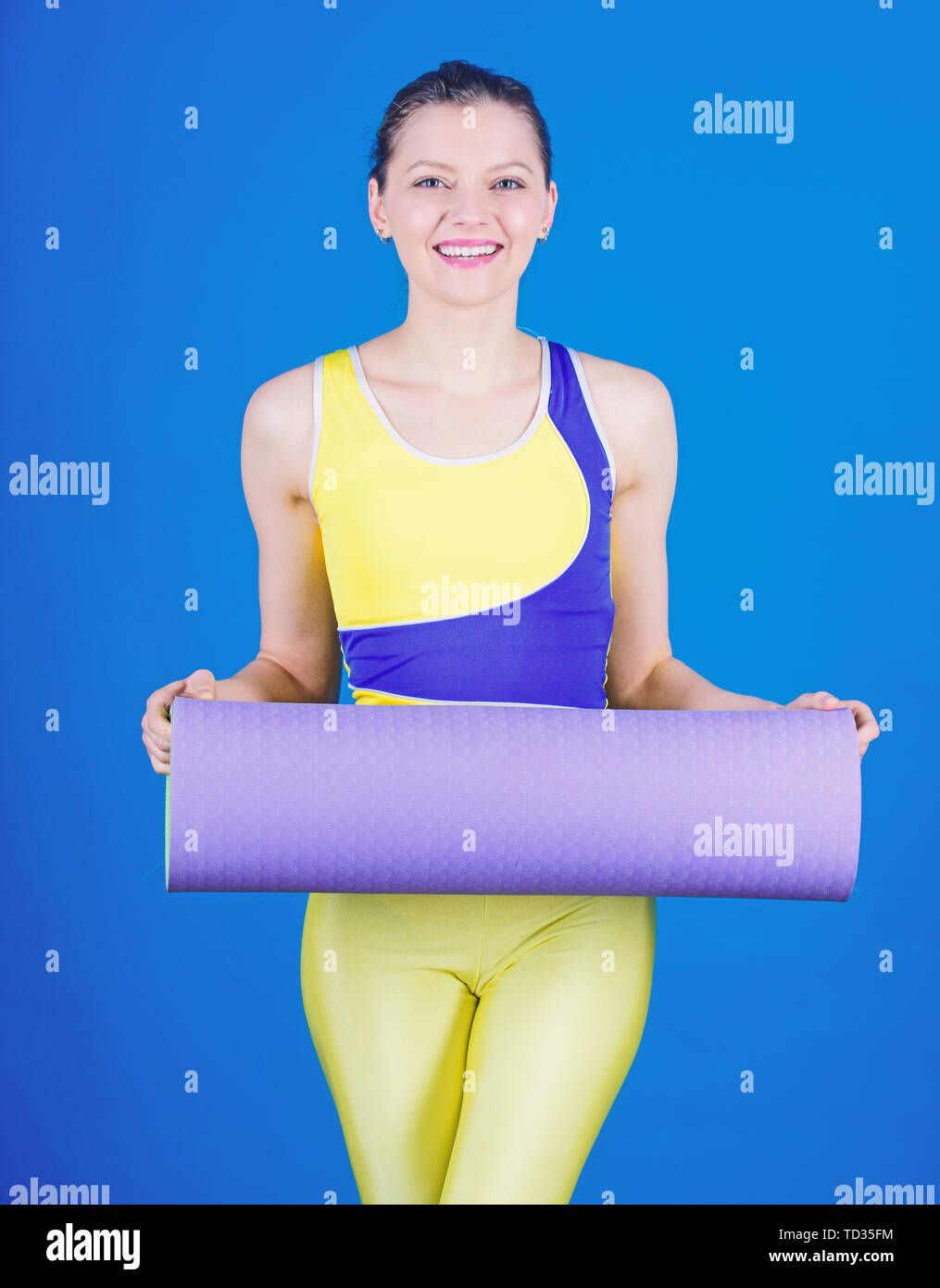 Balance your life. Health diet. Success. Sporty woman training in gym. Sport mat equipment. Athletic fitness. Strong muscles and power. Happy woman workout with fitness mat. sport and balance. - Stock Image