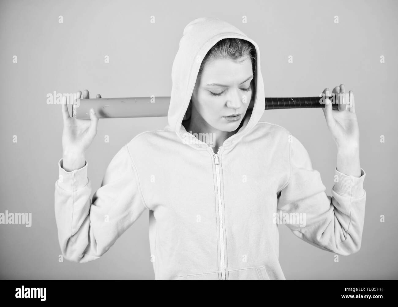 Street life. Sporty girl fighter. Fighting with aggression. Sport equipment. Athletic fitness. aggressive woman with bat. woman workout with baseball bat. clean up the streets. street style woman. - Stock Image