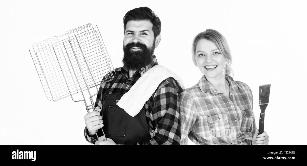 So joyful. Couple in love hold kitchen utensils. Man bearded hipster and girl. Preparation and culinary. Picnic barbecue. food cooking recipe. Tools for roasting meat. Family weekend. - Stock Image