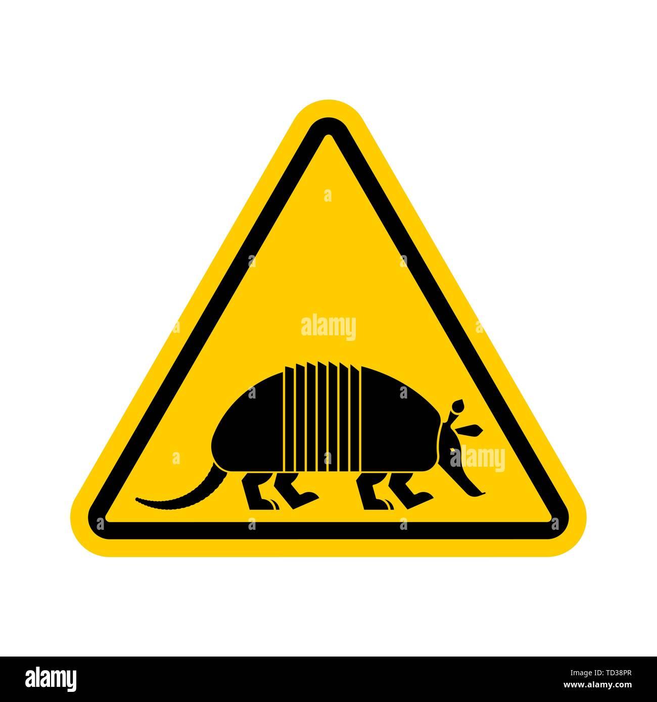 Attention armadillo. Caution Nine-hip Armadillo. Yellow triangle road sign - Stock Image