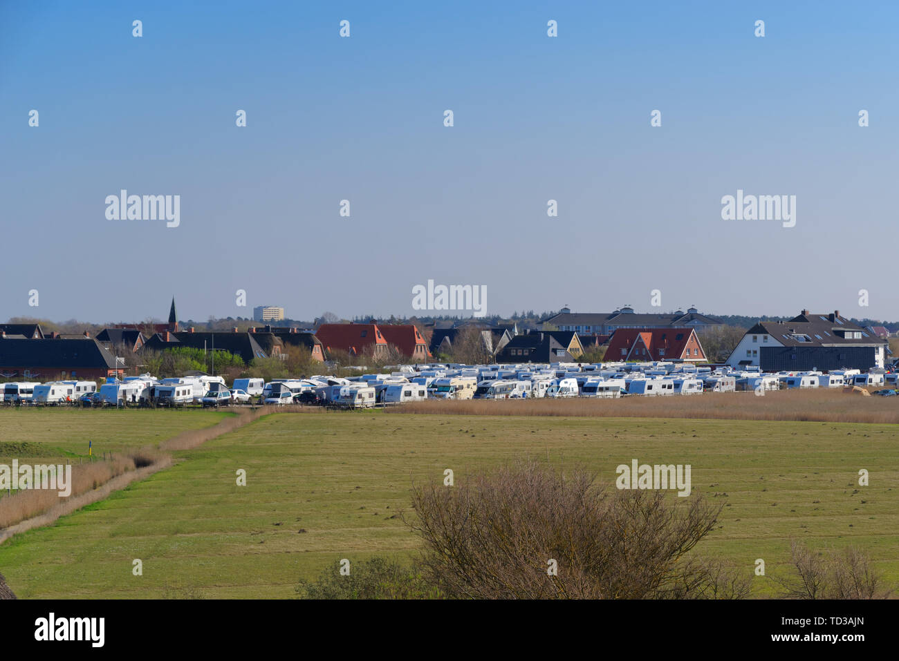 Sankt Peter-Ording, Germany - April 19, 2019: A lot of camping trailers parking in famous holiday region Sankt Peter-Ording, northern Germany Stock Photo