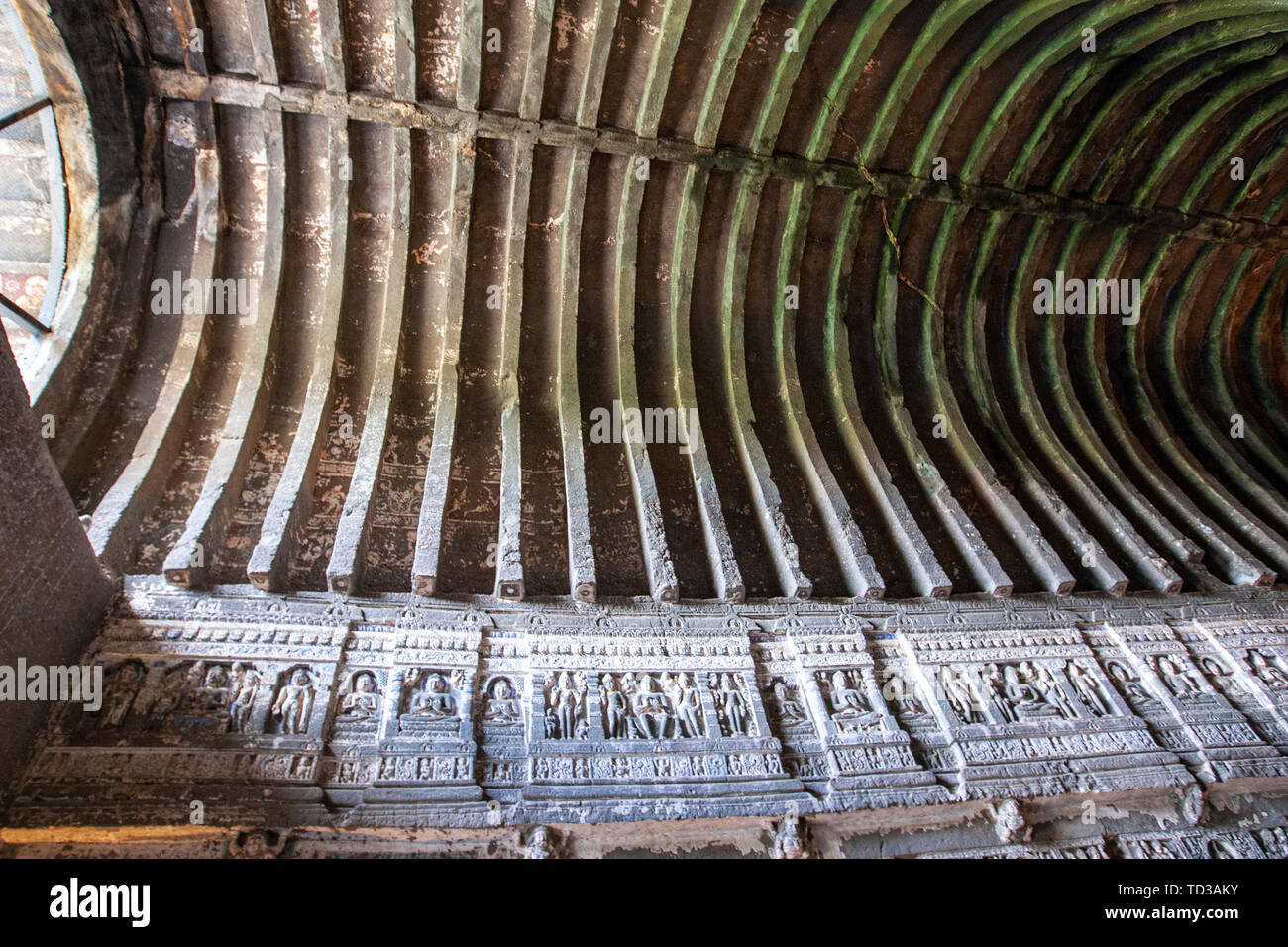 Pillars, brackets and the triforium are extensively carved with Buddhist themes. Cave 26, Ajanta Caves, Aurangabad District, Maharashtra, India Stock Photo