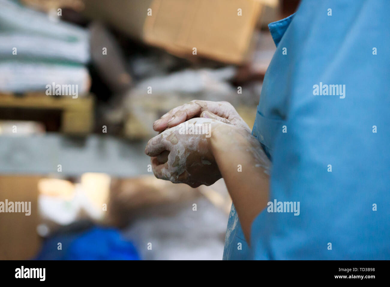 young woman came to study pottery and ceramics. Hands in white clay. training, reportage. Stock Photo