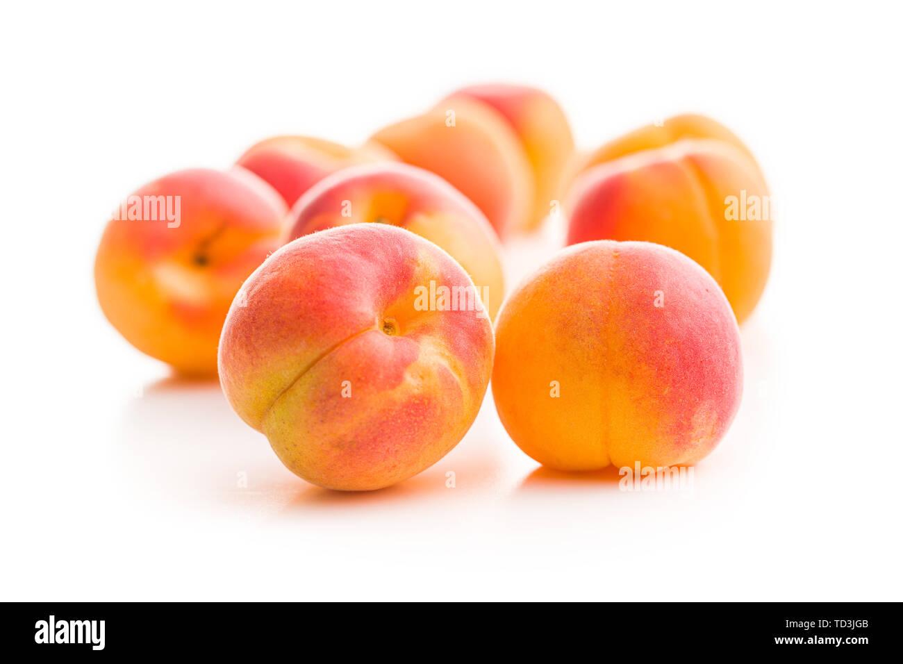 Sweet apricot fruits isolated on white background. - Stock Image