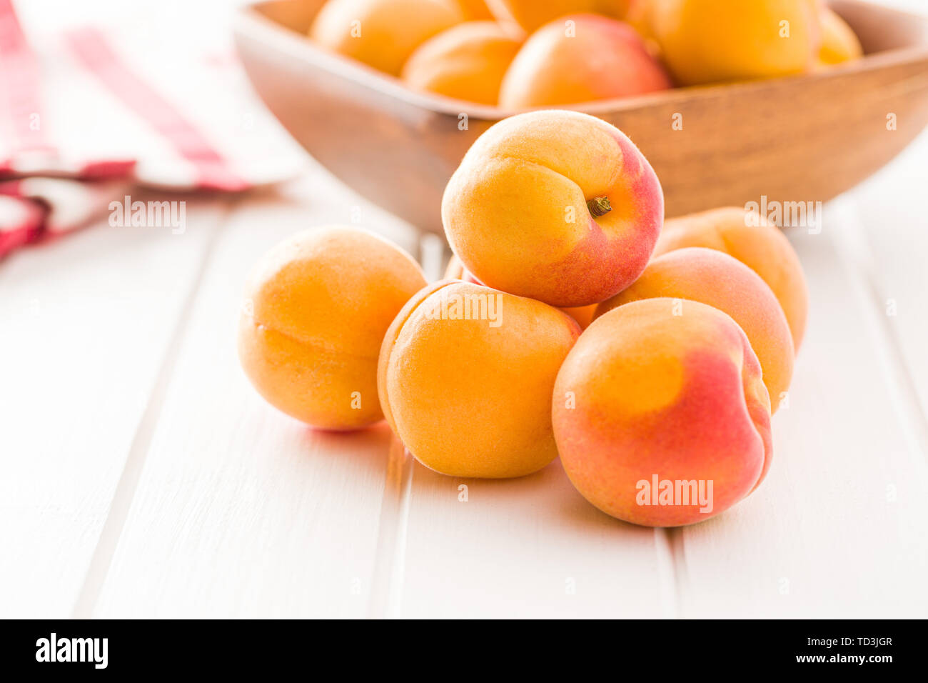 Sweet apricot fruits on white table. - Stock Image
