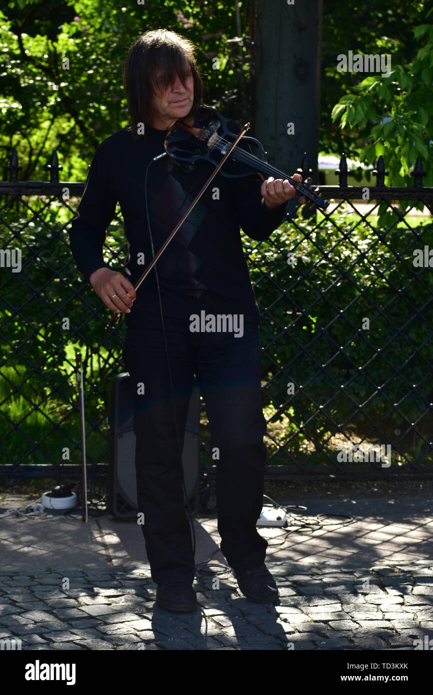 Musician play classical music on violin in the public park. June 3 2019 St.Petersburg Russia Stock Photo