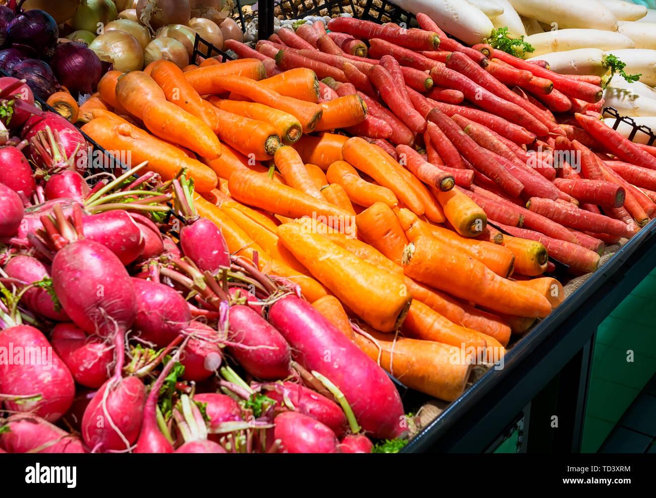 All kinds of radishes on supermarket shelves Stock Photo