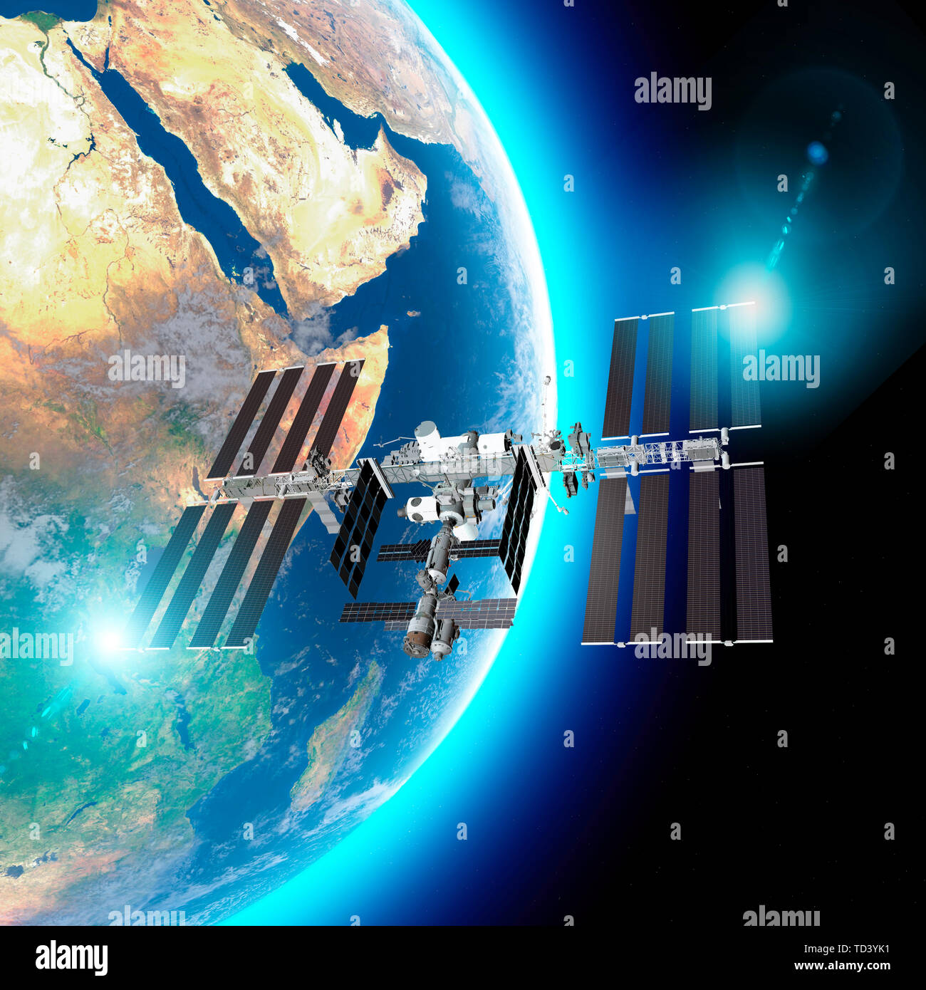 The International Space Station (ISS) is a space station, or a habitable artificial satellite, in low Earth orbit. Satellite view of the earth and ISS - Stock Image