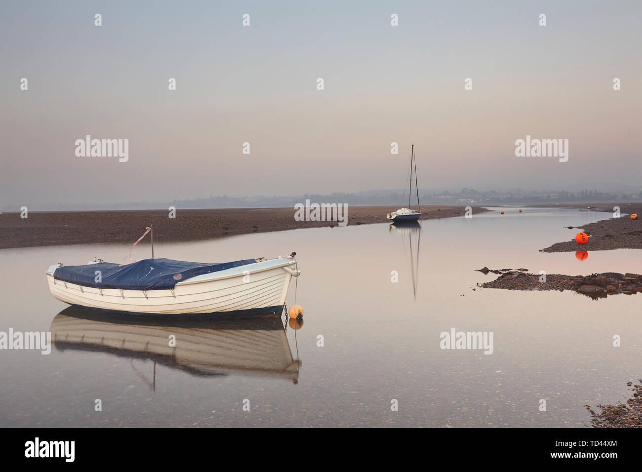 A peaceful calm evening view of the estuary of the River Exe at low tide, Exmouth, Devon, England, United Kingdom, Europe - Stock Image