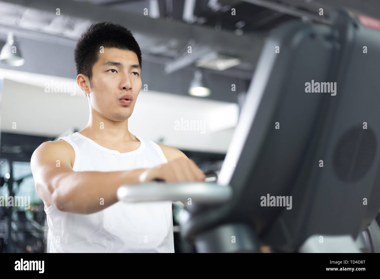 people working out in modern gym - Stock Image