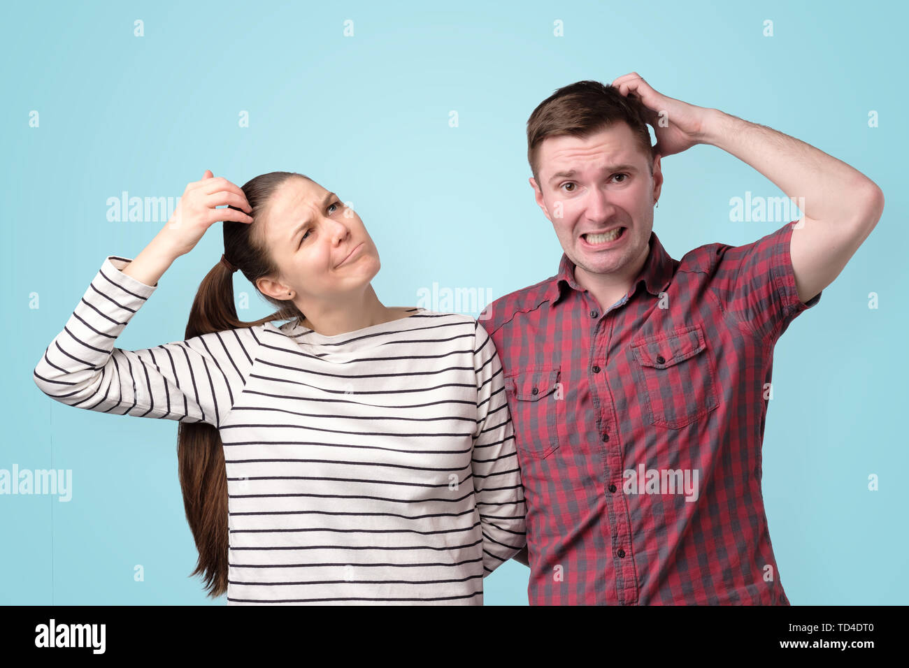Young couple thinking puzzled about their family budget - Stock Image