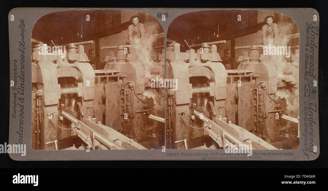 """""""English: Final rolling mill action forming finished steel rails.; English: Underwood & Underwood Stereographs of Manufacturing Industries,  Set 6 - R Stock Photo"""
