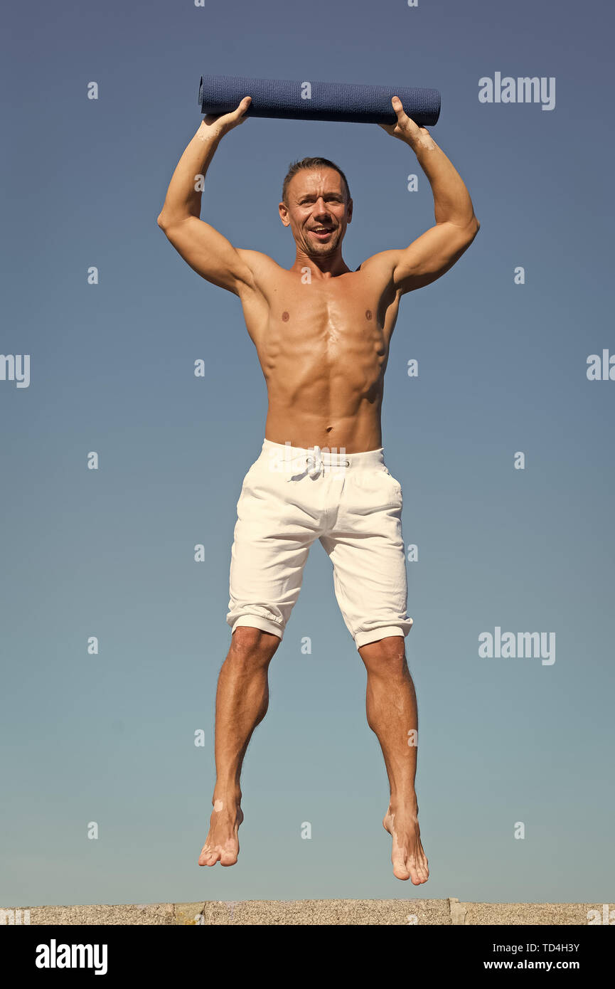I feel like I need the balance. Man do sport and health activities. Muscular man enjoy good health. Developing muscular strength and power. Success in sport. Success is hard work. - Stock Image