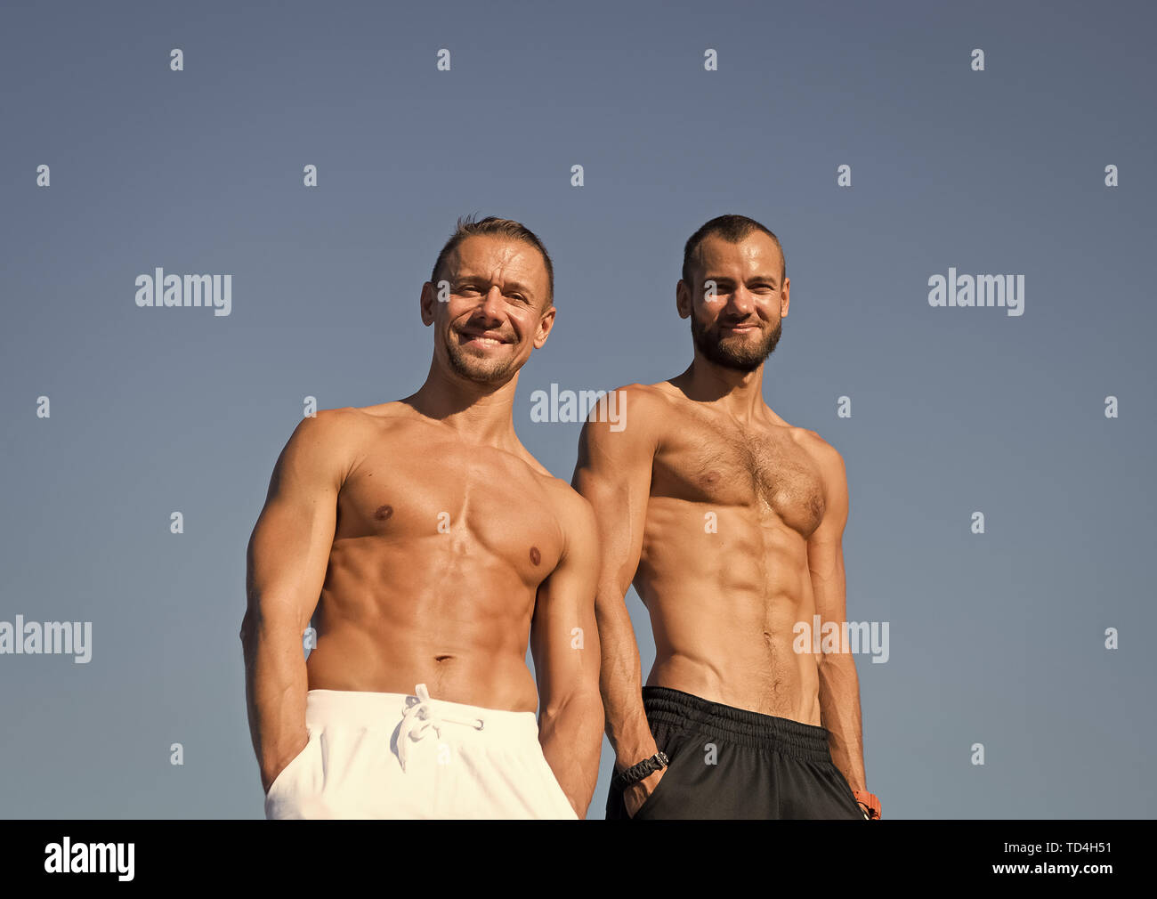 We are one. Strong and muscular men. Fit men with muscular torsos. Sport and health activities. The first wealth is health. Together stronger. - Stock Image