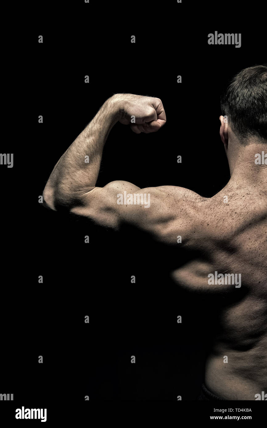 Sportsman flex arm muscles. Man athlete with half torso, back view. Bodybuilder show biceps and triceps. Workout and training activity in gym. Sport power and bodycare concept, vintage. - Stock Image